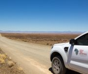 Africa Twin Adventures Back-up Vehicle on straight Karoo road
